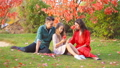 Portrait of happy family of four in autumn 58546900
