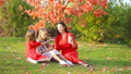 Little girl with mom outdoors in park at autumn day 58668445