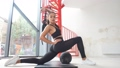 Young female training in gym, do fitness exercises. 58690575