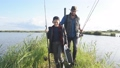 Adult father and teenager son going to fishing together. 58705427