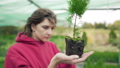 Florist inspects the plant. Control and verification of seedlings. Biologist studies the root of an 58716807