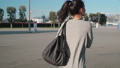 Young woman with gym bag walking in the street 58954245
