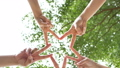 4K. successful team:  five peoples raise two fingers together as a star on sky background. connection people to convey the cooperation in the work. 59032081