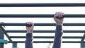 Man hanging in horizontal bar moving ahead. 59384811
