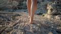 woman is walking on rocks in summer, close up of legs 59525447