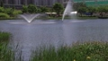 Fountain sprinkled by the lake 59656146