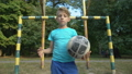 Self-confident boy footballer with ball looking at 59857727