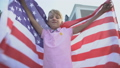 American young boy waving USA flag, celebrating 59857733
