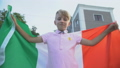 Italian football fan waving national flag 59857734