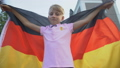 Patriot young boy waving German flag, celebrating 59857735