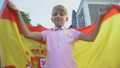 Spanish football fan waving national flag 59857736