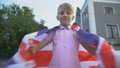 Young boy waving British flag, celebrating 59857737