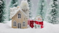 Snowman and house in winter 59871701