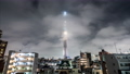4K time-lapse of Tokyo Skytree at night advertising light show count down to Tokyo Summer Olympic 2020. Japan tourism landmark, Asia travel destination, Japanese tourist attraction concept. Zoom out 59922575