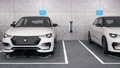 Electric self driving cars connected to charging stations in park garage front 60015651