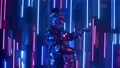 A man dances in neon light in a glass suit. Shiny sparkling silver suit, and blue purple neon light 60075716