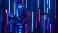 A man dances in neon light in a glass suit. Shiny sparkling silver suit, and blue purple neon light 60075721