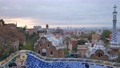 Barcelona city view from Guell Park. Sunrise view of colorful mosaic building in Park Guell. 60079409
