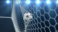 Soccer ball flies beautifully into the goal in slow motion. Soccer ball flies into the goal bending the grid on, ball rotating in slow motion. Moment of delight in football 3d FullHD animation 60333490