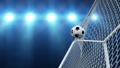 Soccer ball flies beautifully into the goal in slow motion. Soccer ball flies into the goal bending the grid on flares background, ball rotating in slow motion. Moment delight football 3d FullHD 60333495