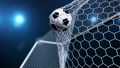 Soccer ball flies beautifully into the goal in slow motion. Soccer ball flies into the goal bending the grid on flares background, ball rotating in slow motion. Moment delight football 3d FullHD 60333502