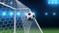 Soccer ball flies beautifully into the goal in slow motion. Soccer ball flies into the goal bending the grid on flares background, ball rotating in slow motion. Moment delight football 3d FullHD 60333504