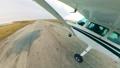 Light plane landing on a runway in fields. 60381979