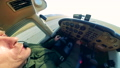 Male pilot takes off, driving a small plane. 60381984