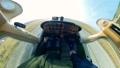 Man drives light aircraft, taking off. 60381986