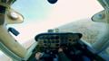 One pilot flies light airplane over fields. 60381988