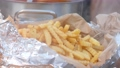 French fries wrapped in aluminium foil in Food stall of market 60475984
