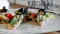 Modern plate with trendy decorated tasty fish dish with mushrooms and vegetables 60584773