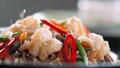 Sesame seeds is falling on traditional asian soba stir-fry noodles with shrimp  60595059