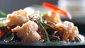 Sliced chili is falling on traditional asian soba stir-fry noodles with shrimp  60595062
