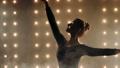 Silhouette of ballerina in black tutu is dancing ballet in the dark studio. 60595068