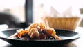 Sesame seeds is falling on traditional asian soba stir-fry noodles with shrimp  60655991