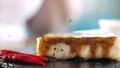 Sprinkles a sesame seeds on serving original asian spring rolls, close-up. 60655994