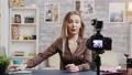 Beautiful beauty vlogger filming makeup tutorial product 60732620