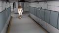 Space cyborg trooper walking in sci-fi corridor. 60956786