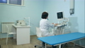 Woman doctor working at ultrasound diagnostic machine 60960531