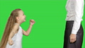 Happy mother giving high five to her little daughter on a Green Screen, Chroma Key 60960532