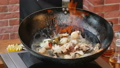 Cooking and mixing seafood in the pan 60988629