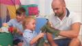 Happy parents and two little boys playing with puppets 61177489