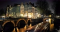 Amsterdam city skyline night time lapse at canal waterfront, Amsterdam, Netherlands, 4K Time Lapse 61253917