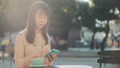 Businesswoman having coffee breack outdoors. 61659625
