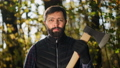 Portrait of a handsome bearded man with an ax 61868251