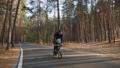 Dad teaches little son to ride a balance bike 61868266