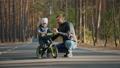 Dad teaches little son to ride a balance bike 61868267