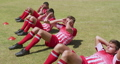 Soccer players exercising on field 62464747
