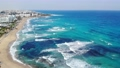 Drone view of blue sea water with waves and beaches in protaras with hotel resorts, Cyprus 62772132